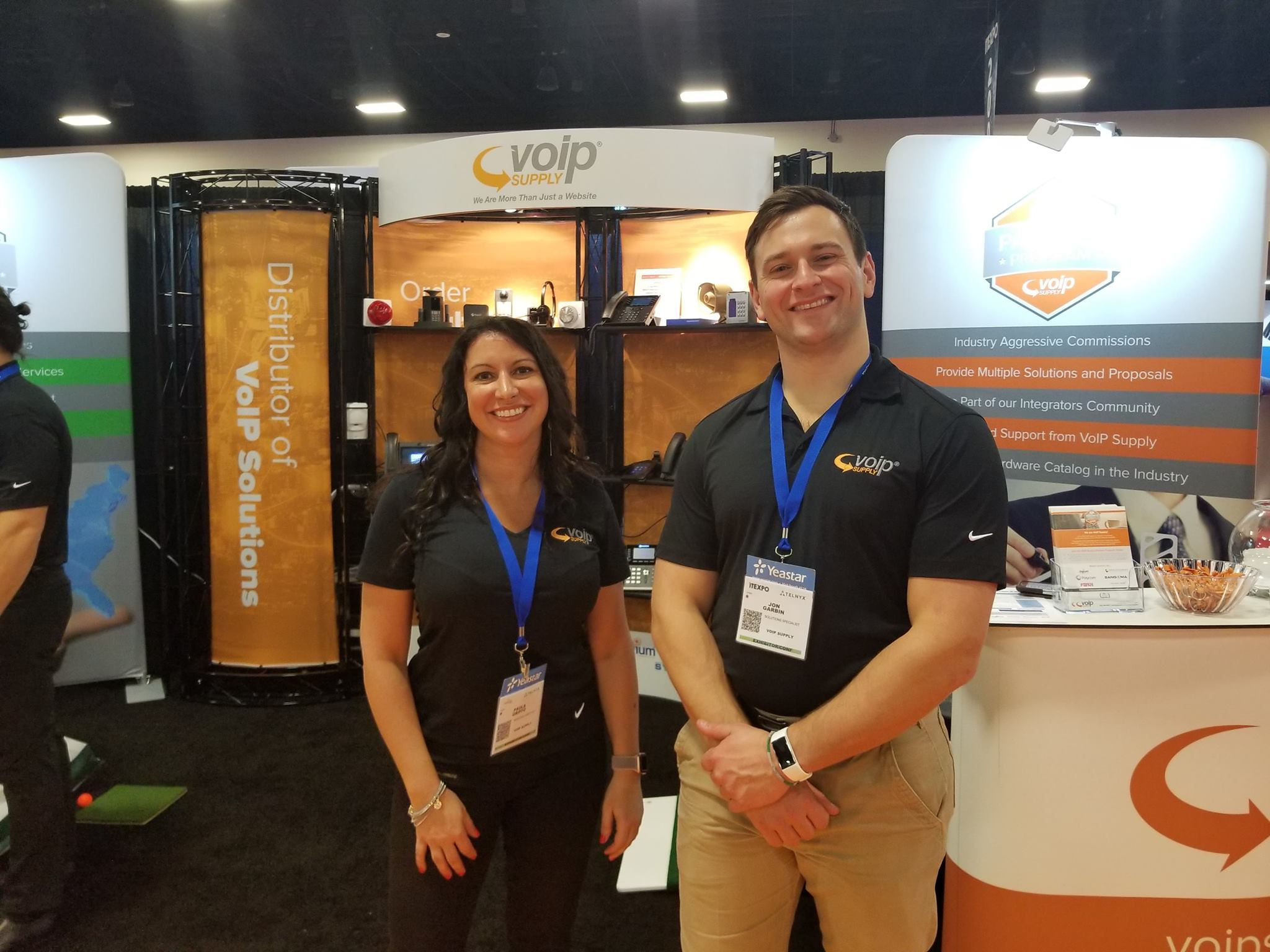 Happy VoIP Supply Sales Reps at a Trade Show